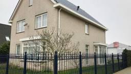 Het huis van de verdachte in Werkendam.