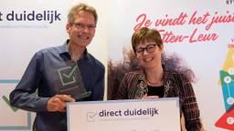Henk Buesink en burgemeester De Vries van Etten-Leur.