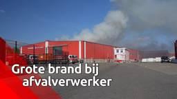 Dikke rookpluimen stijgen op bij brandende afvalverwerker in Dongen