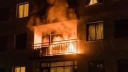 Een woningbrand in Tilburg. (Archieffoto: Jack Brekelmans/SQ Vision).
