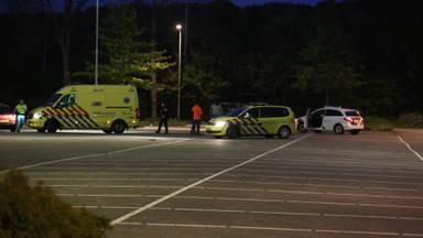 Hulpdiensten op de parkeerplaats in Roosendaal waar het slachtoffer werd gevonden (foto: Christian Traets/SQ Vision)