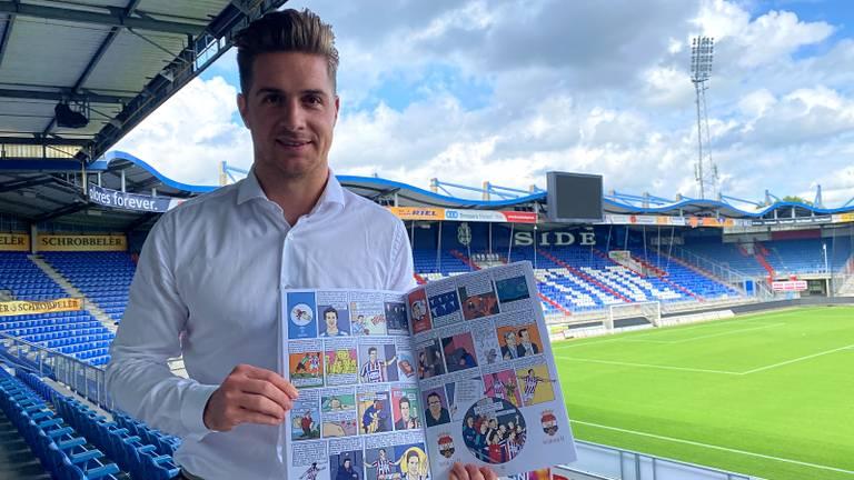 Jordens Peters met 'zijn' pagina in het historische stripboek van Willem II.
