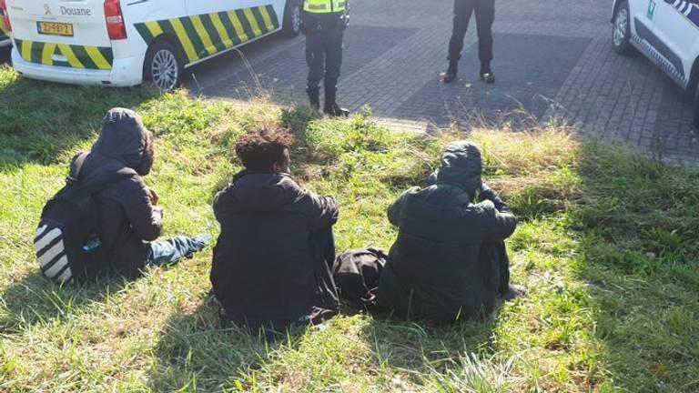 Drie van de verstekelingen (foto: politie).