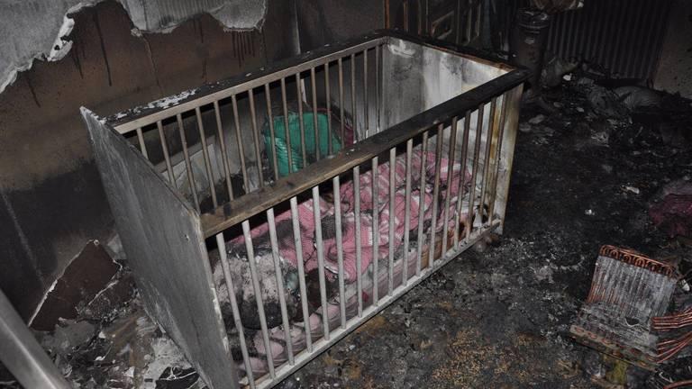 De moeder redde haar kindje uit de brandende kamer (foto: Brandweer Midden- en West-Brabant).
